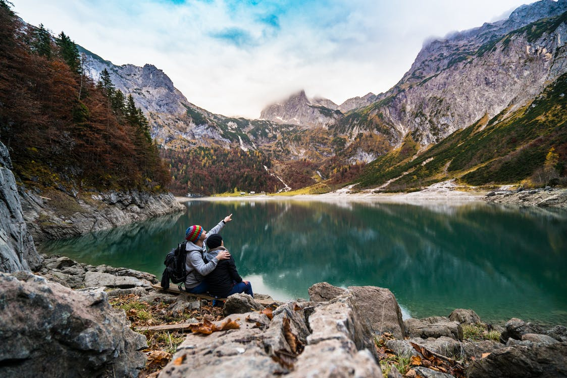 loving couple by lake and mountains