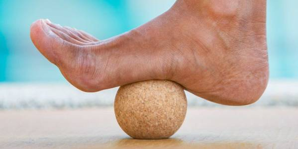 Close-up of cork acupressure ball used with foot