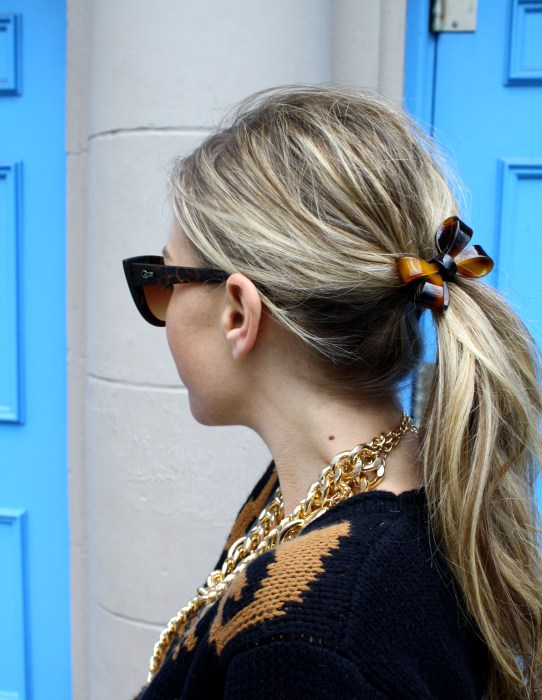 Put a bow on it, Leopard slip-ons, Quilted leather skirt, Pencil skirt, Cross-body bag, Chunky Sweater, Ponytail