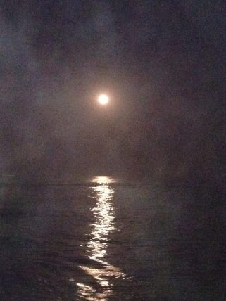 Full moon in fog shimmers over the Pacific Ocean from Malibu Road