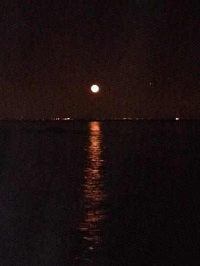 Moon gazing at its best with a moon shimmering over the Pacific Ocean