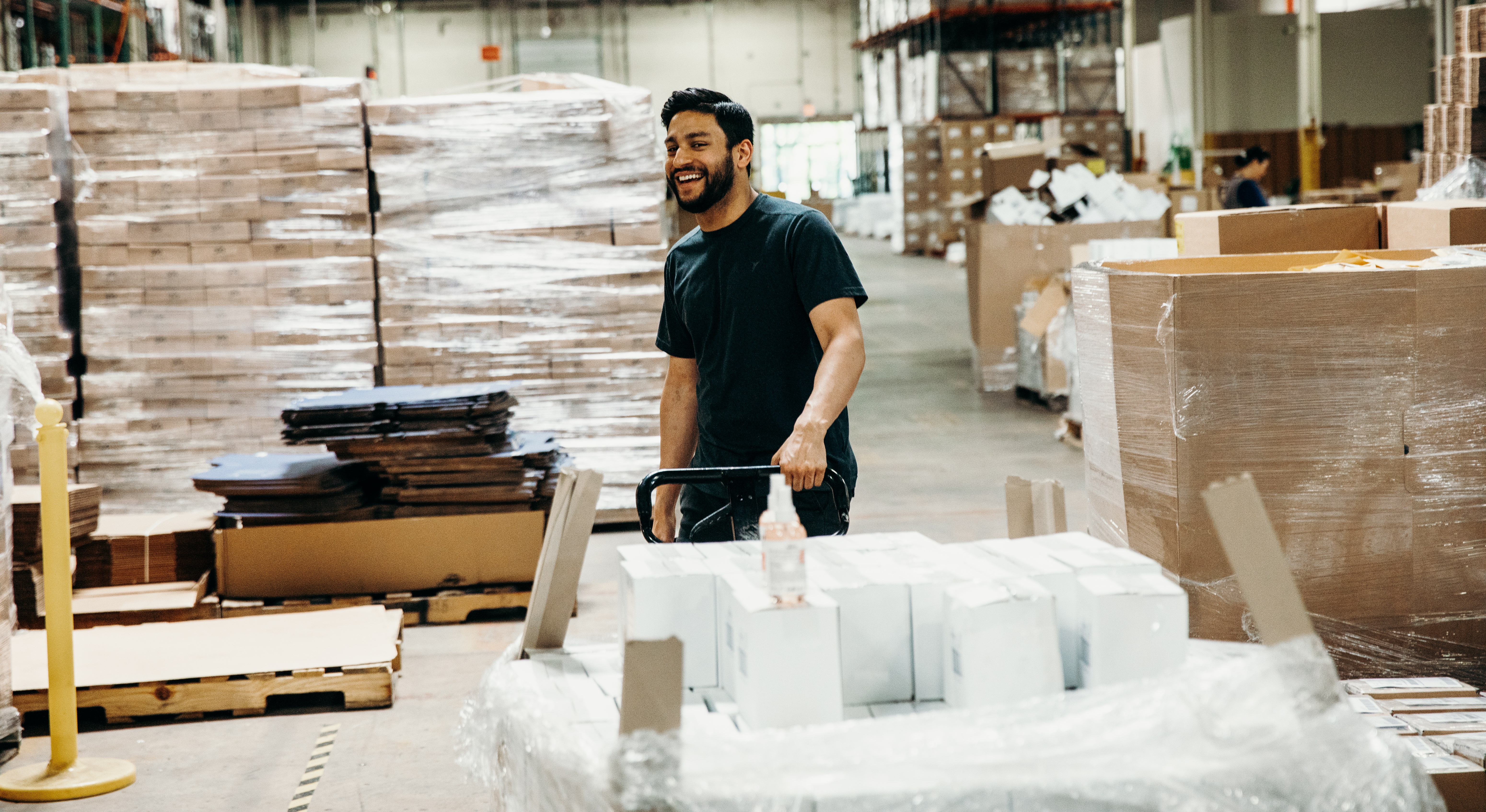warehouse worker smiling