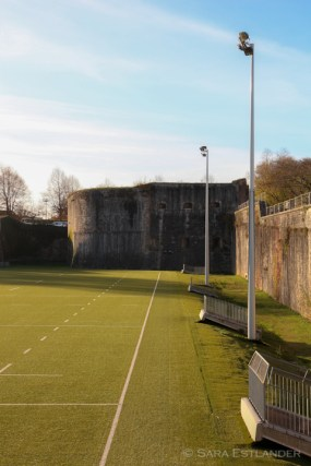 Part of the moat by the old city wall in Bayonne has been converted into a rugby field.
