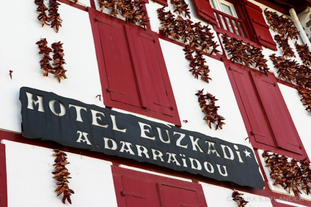 A hotel in Espelette decorates its walls with dried chili peppers, basque style.
