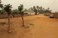 The street outside the gate of the centre, one hazy morning.
