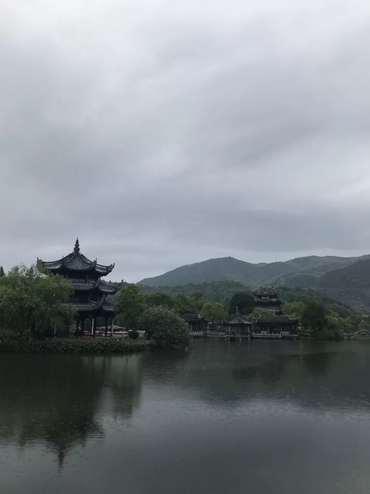 A pagoda next to a lake in East Lake Park, Linhai, Zhejiang, China.