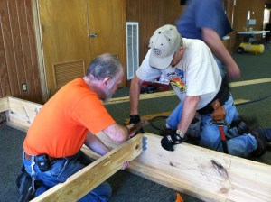 Frank and Rich building a base for the stage expansion in one of the conference rooms.