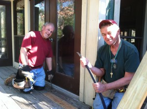 Tony and Don replacing bad boards on the deck of a residence hall.