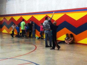 Counselors help the kids release some steam with a run-around game in the gym.