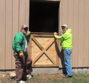 We built and installed new doors for the barn.  We also rebuilt some of the upper doors of the barn hay loft.