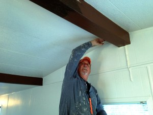 Rich putting some final touches on the ceiling beams.