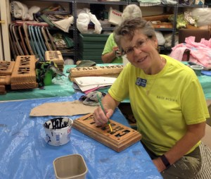 Jenny painting signs.