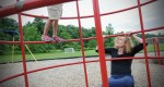 Joy Ladin plays with her youngest daughter at a playground in Amherst, Massachusetts.