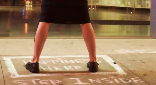 "An art project chalked on the sidewalk in the Bowery District of Manhattan reads: ""Consider for a moment what happiness means to you and step inside the box; it could be anywhere you want, really."""
