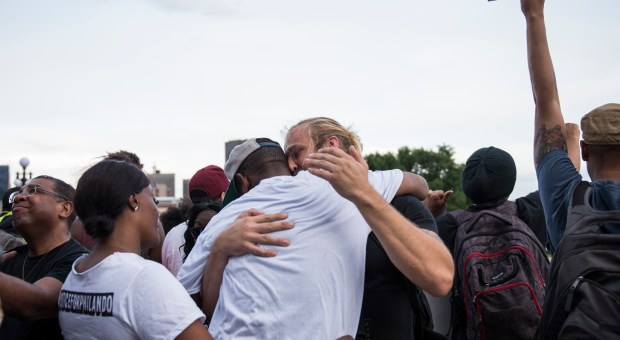 John Thompson, a friend and former colleague of Philando Castile, is embraced after speaking on the steps of the Minnesota State Capitol building on June 16, 2017 in St Paul, Minnesota.