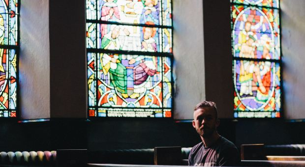 A man sits in a church.
