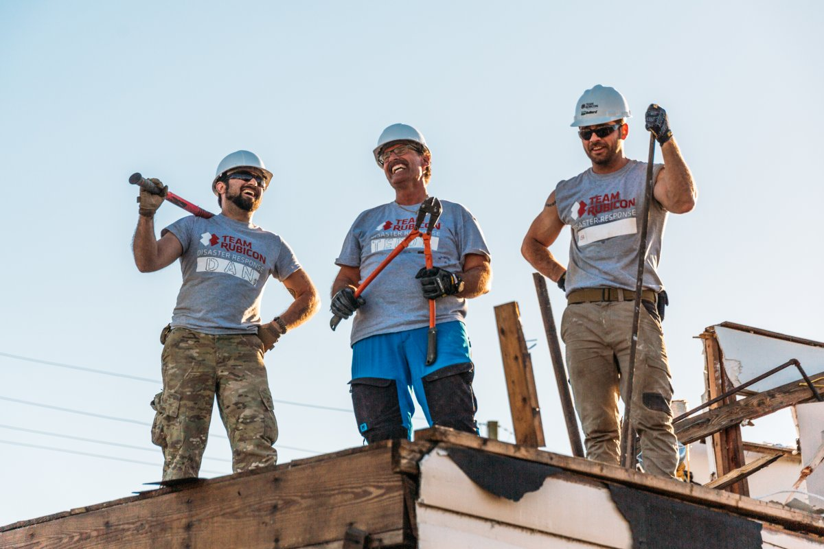 Members of Team Rubicon work on a house