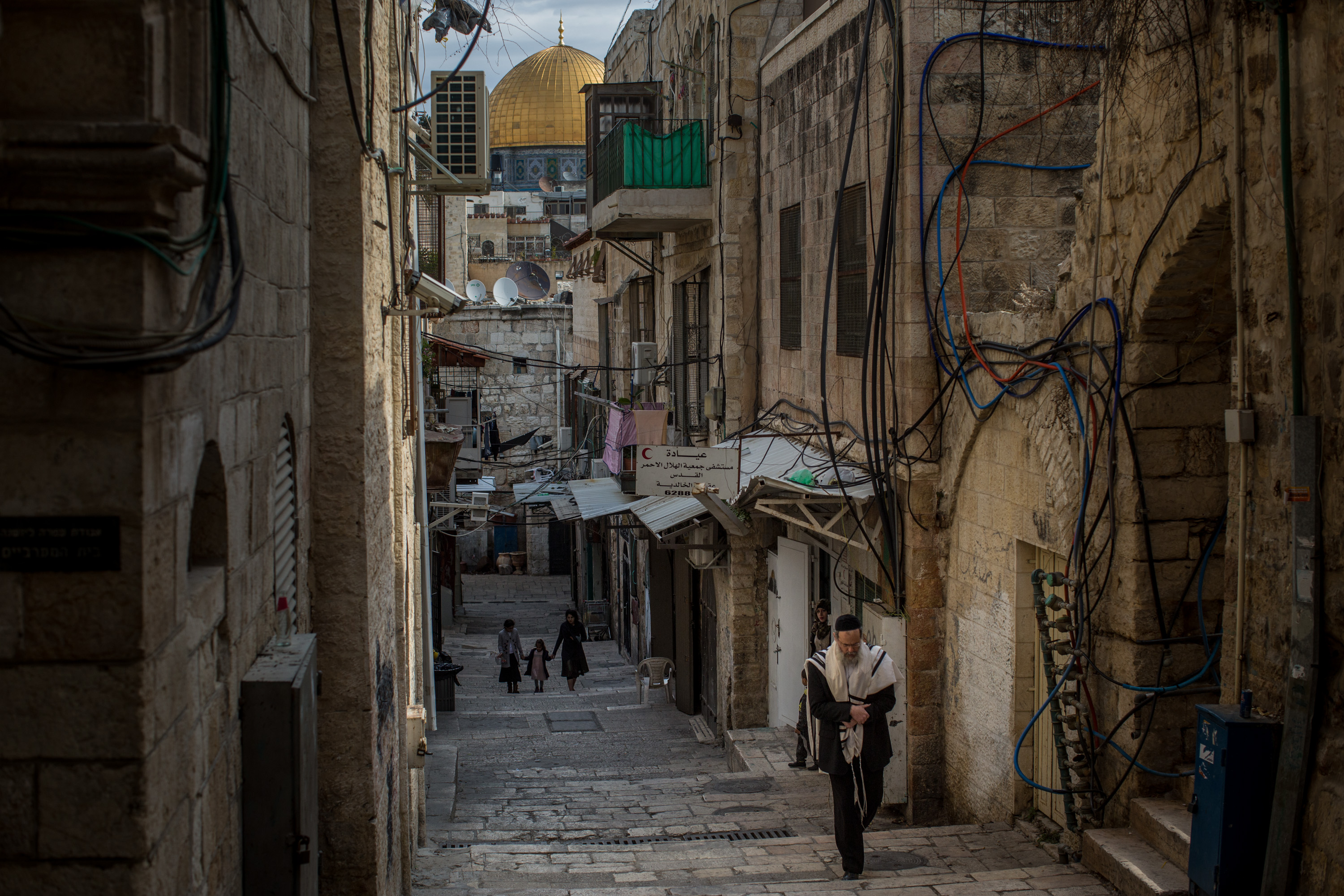 A Jewish man is seen walking through the Old City during shabbat, the Jewish day of rest and seventh day of the week, on January 14, 2017 in Jerusalem, Israel.