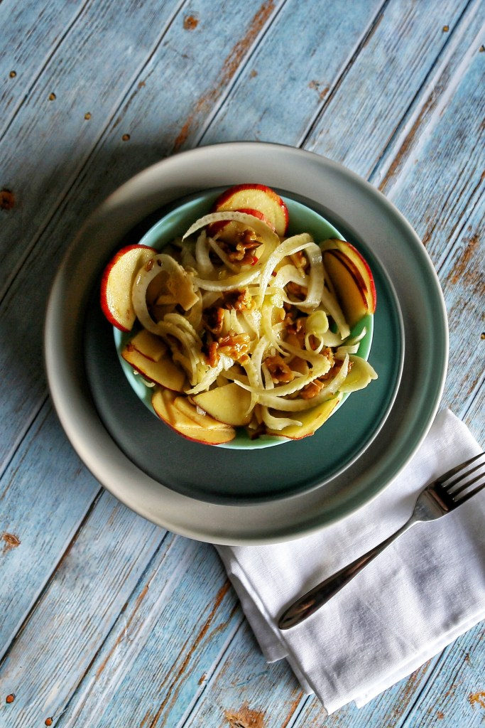 Apple and fennel salad on a plate.