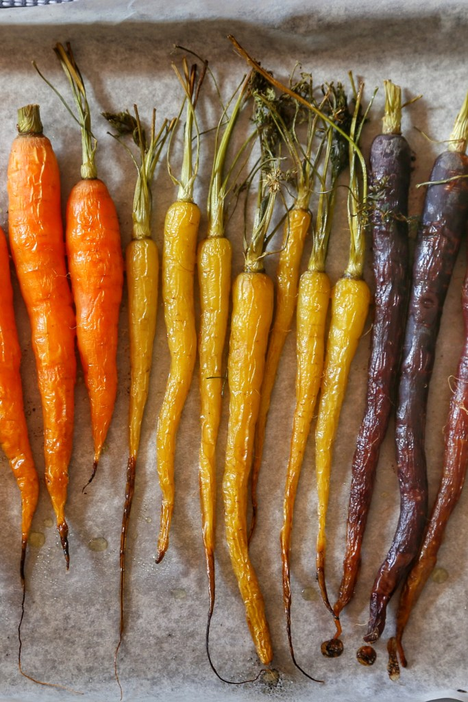A bunch of roasted rainbow carrots.