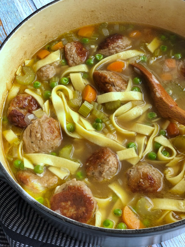 Meatball noodle soup in a large pot.