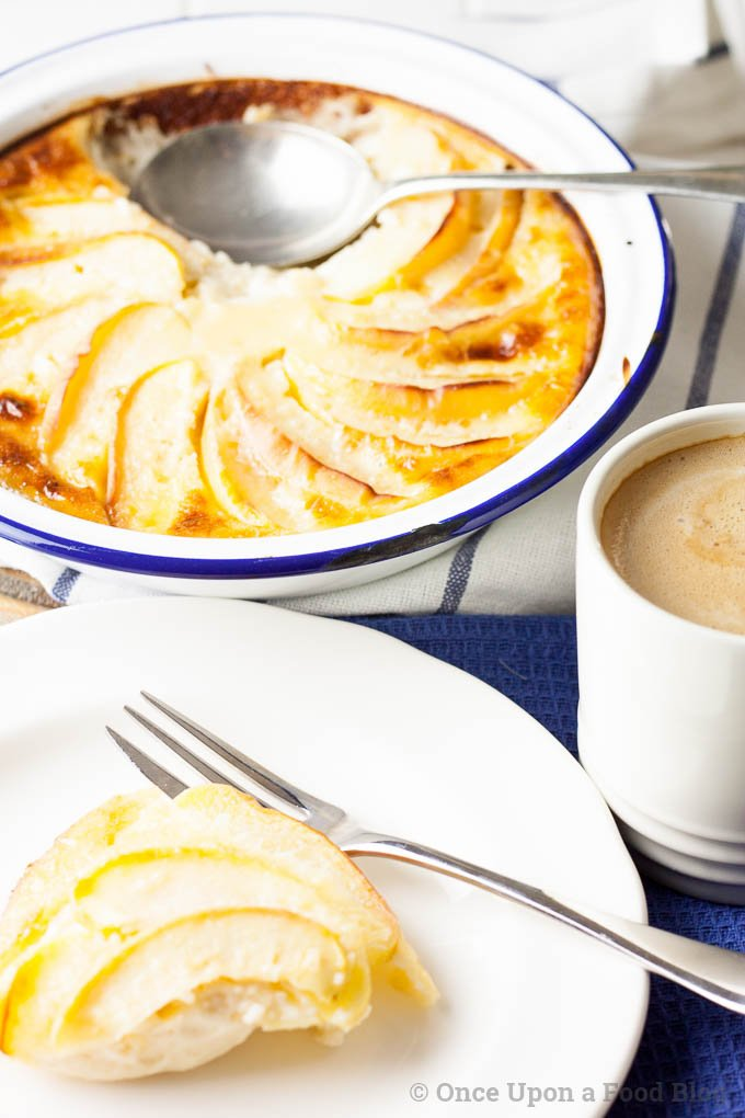 Creamy set 'custard' spiked with brandy and topped with soft baked apple. This is a gorgeous quick and easy autumn dessert.