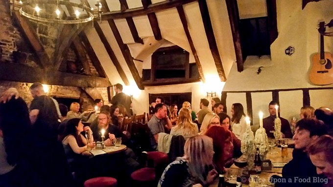 People enjoying a meal at the House of Trembling Madness in York, England