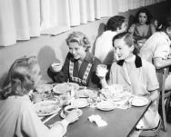 Grace Kelly eating with Ann Blyth and Janet Leigh in the MGM commissary. Elizabeth is in the background