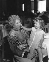 Harpo Marx with Shirley Temple in the studio commissary during the filming of Duck Soup,