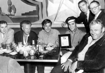 Robert Wagner, Elvis Presley and Alan Hale Jr. lounge around the 20th Century Fox commissary circa October, 1956