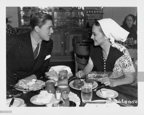 Ronald Reagan and Olivia de Havilland eating lunch together at the Warner Bros Studio commissary