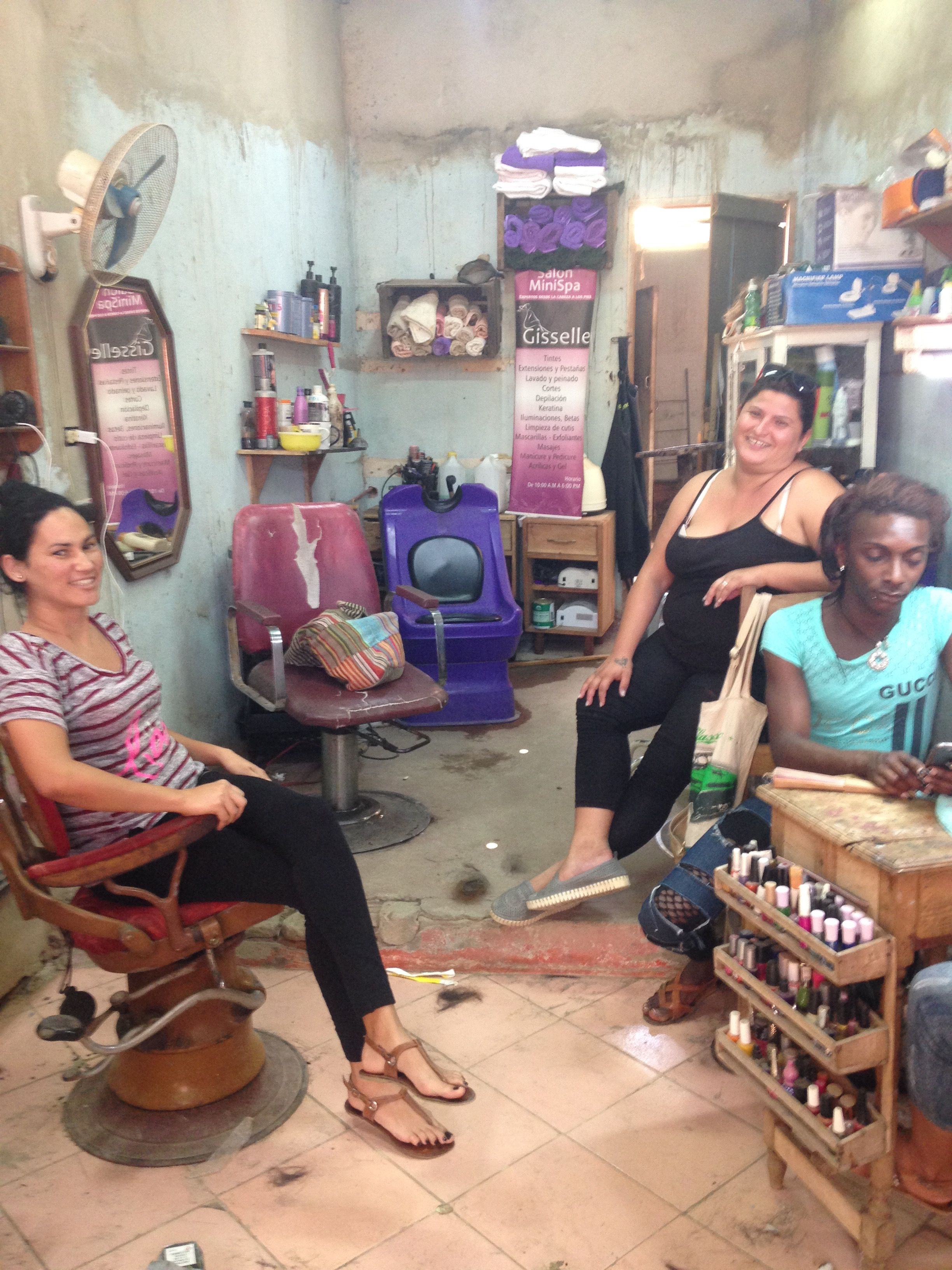 Yisel, dressed in black, is the proud owner of Salon Giselle in Trinidad, Cuba, where she and her employees make their living beautifying local women. Photo by Caroline Kelly