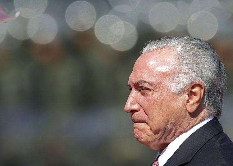El presidente brasileño Michel Temer llega a la ceremonia por el Día del Soldado en la sede de la Armada en Brasilia, Brasil, el viernes 24 de agosto de 2018. Foto: Eraldo Peres / AP.