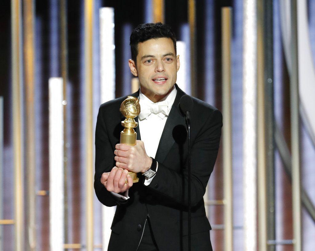 """Rami Malek recibe el Globo de Oro al mejor actor en una película de drama por su trabajo en """"Bohemian Rhapsody"""", el domingo 6 de enero del 2019 en Beverly Hills, California. Foto: Paul Drinkwater / NBC vía AP."""