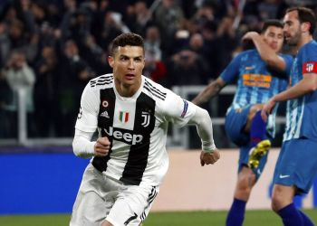 Cristiano Ronaldo de Juventus tras anotar de penal el tercer gol para la victoria 3-0 ante el Atlético de Madrid en el partido de vuelta de la eliminatoria de octavos de la Liga de Campeones en Turín, Italia, el martes 12 de marzo de 2019. (AP Foto/Antonio Calanni)