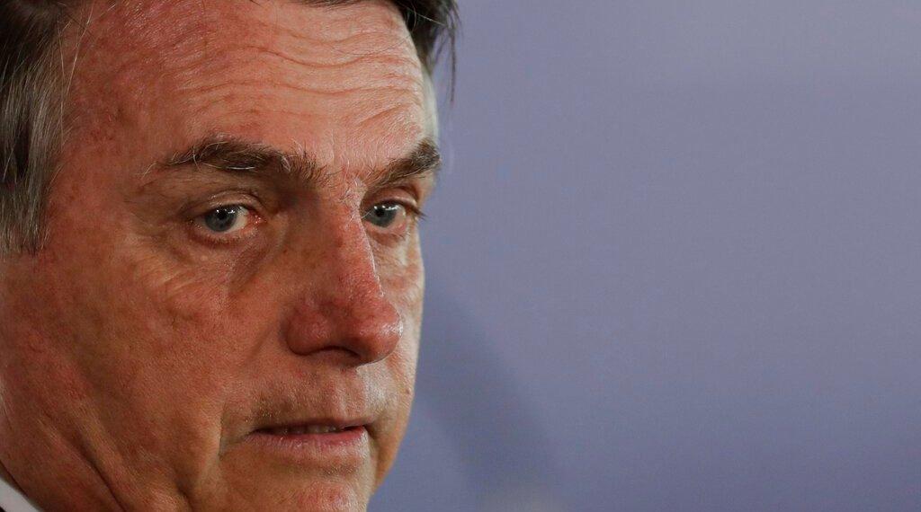 El presidente de Brasil Jair Bolsonaro asiste a una ceremonia de condecoración de la Medalla de Mérito Mauá en Brasilia, el jueves 15 de agosto de 2019. (AP Foto/Eraldo Peres)