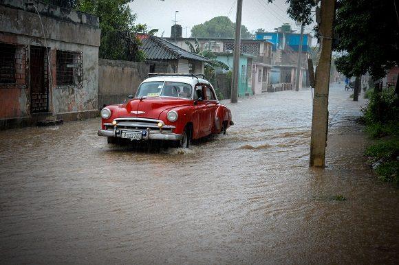Lluvias localmente intensas, registradas en la tarde del 5 de octubre de 2019, que inundaron algunas zonas de la ciudad de Holguín, en el oriente de Cuba. Foto Juan Pablo Carreras / ACN.