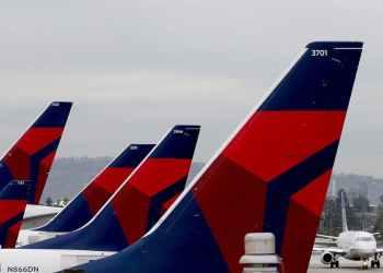 Varios aparatos de Delta Airlines estacionados en la placa del Aeropuerto Internacional de Atlanta. | Delta