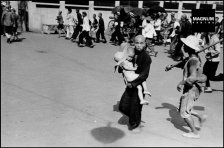 CHINA. Hubei. Hankou. July-Sept, 1938. Running for shelter during an air raid.