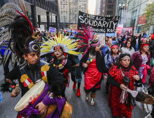 epaselect epa05629143 Native American protestors are joined by anti-Trump and other protestors as they march showing their opposition to the Dakota Access Pipeline, in Chicago, Illinois, USA, 12 November 2016. The 1,100 mile (1,770 km) long Dakota Access Pipeline, which is being built to bring Canadian and US Northwest oil to Chicago, has become a focal point of Native American rights because of its proximity to the Standing Rock Sioux Reservation and other parts that they believe infringe on their land. EPA/TANNEN MAURY