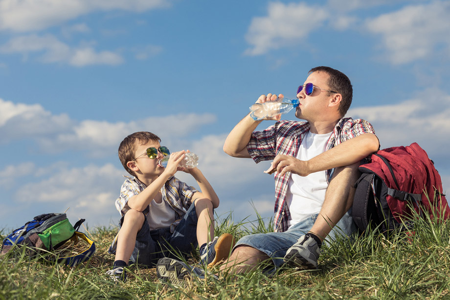 Father And Son Rest Eat Hiking