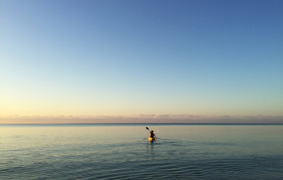 Man Kayak Fishing On Open Water