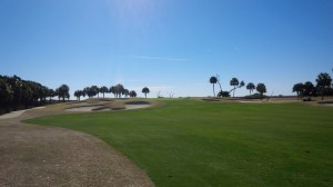 The view from just off the 10th fairway, where you are close enough to smell the Atlantic Ocean just beyond those palm trees behind the green.