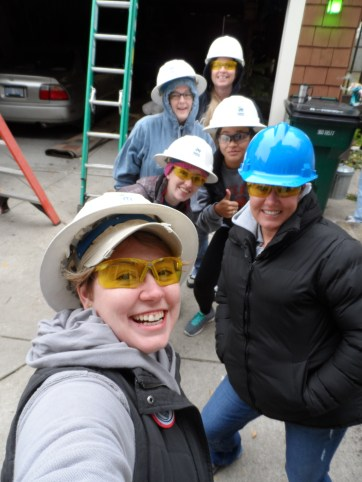 Elm staff pose for the camera at Habitat for Humanity