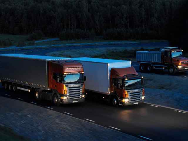 Three-orange-Scania-trucks.jpg?resize=640%2C480&ssl=1