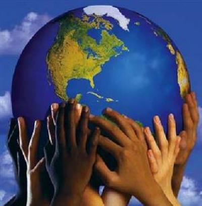 Image of many hands holding up a globe