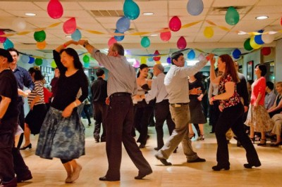 A celebration with people dancing.