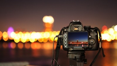 A camera taking a picture of the city.