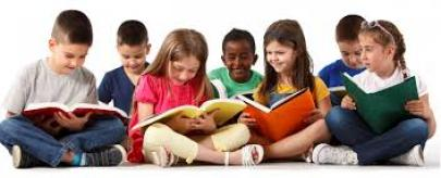 This image shows young children advancing their literacy skills via reading.