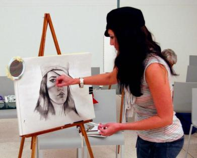 Picture of a woman drawing a portrait